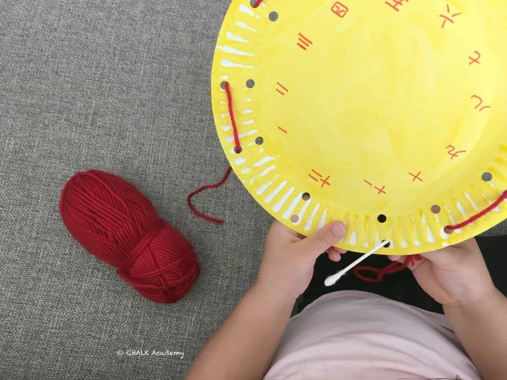 Paper Plate Clock Face Threading - A Fine Motor Numbers Activity for Kids!