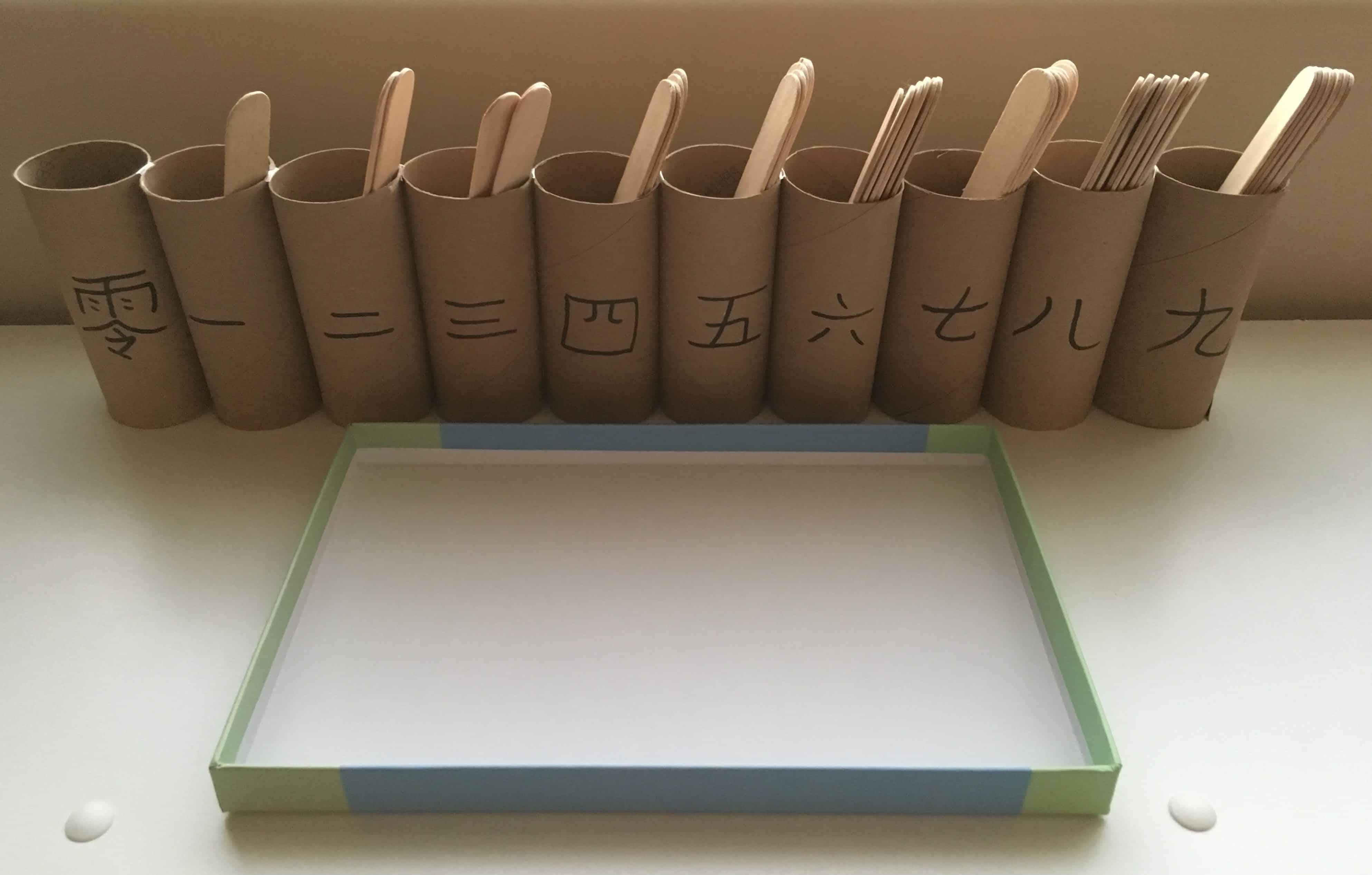 DIY Montessori Spindle with Craft Sticks and Cardboard Rolls