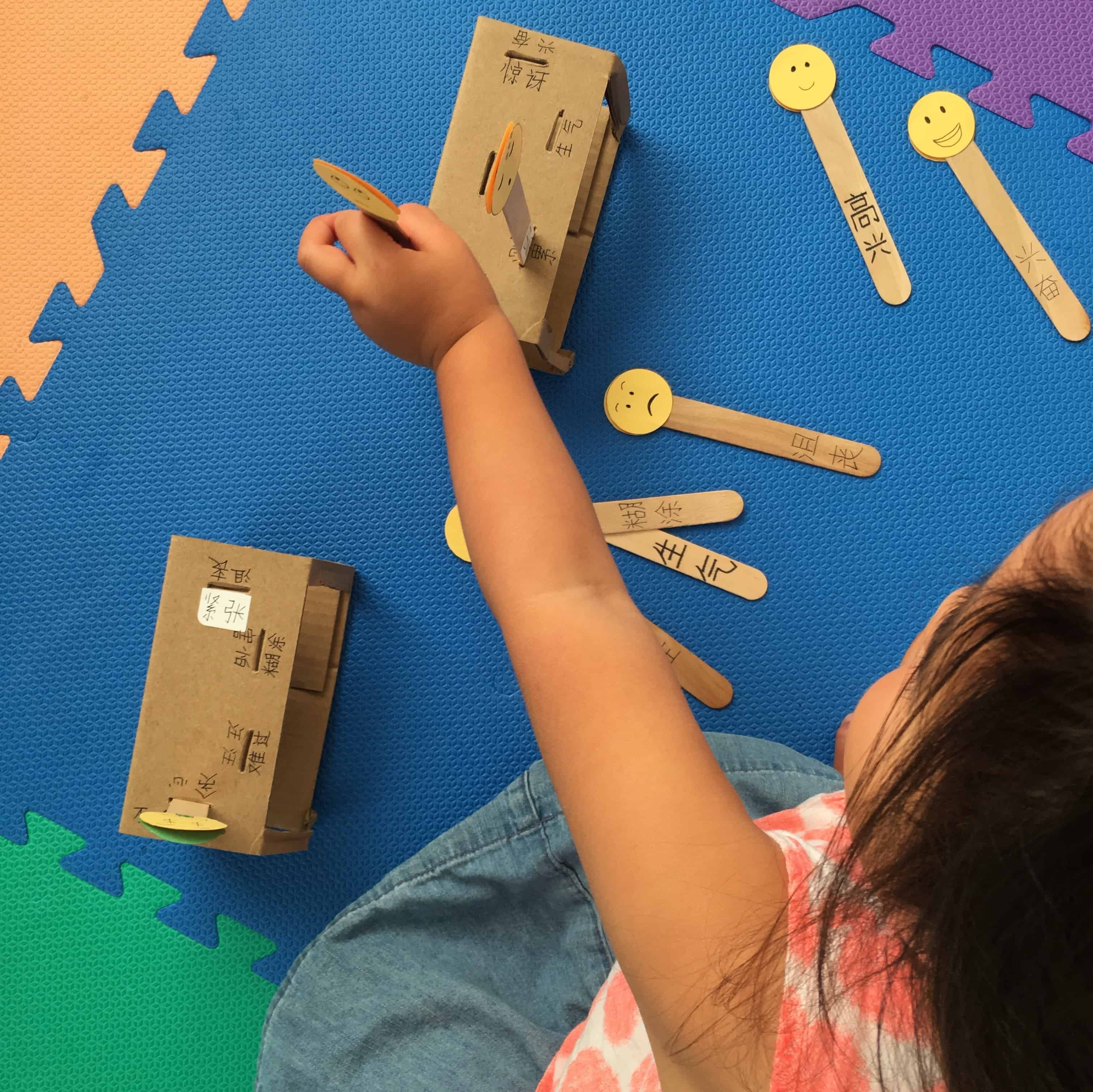 Emoji Matching Activity with Craft Sticks and Cardboard Slots