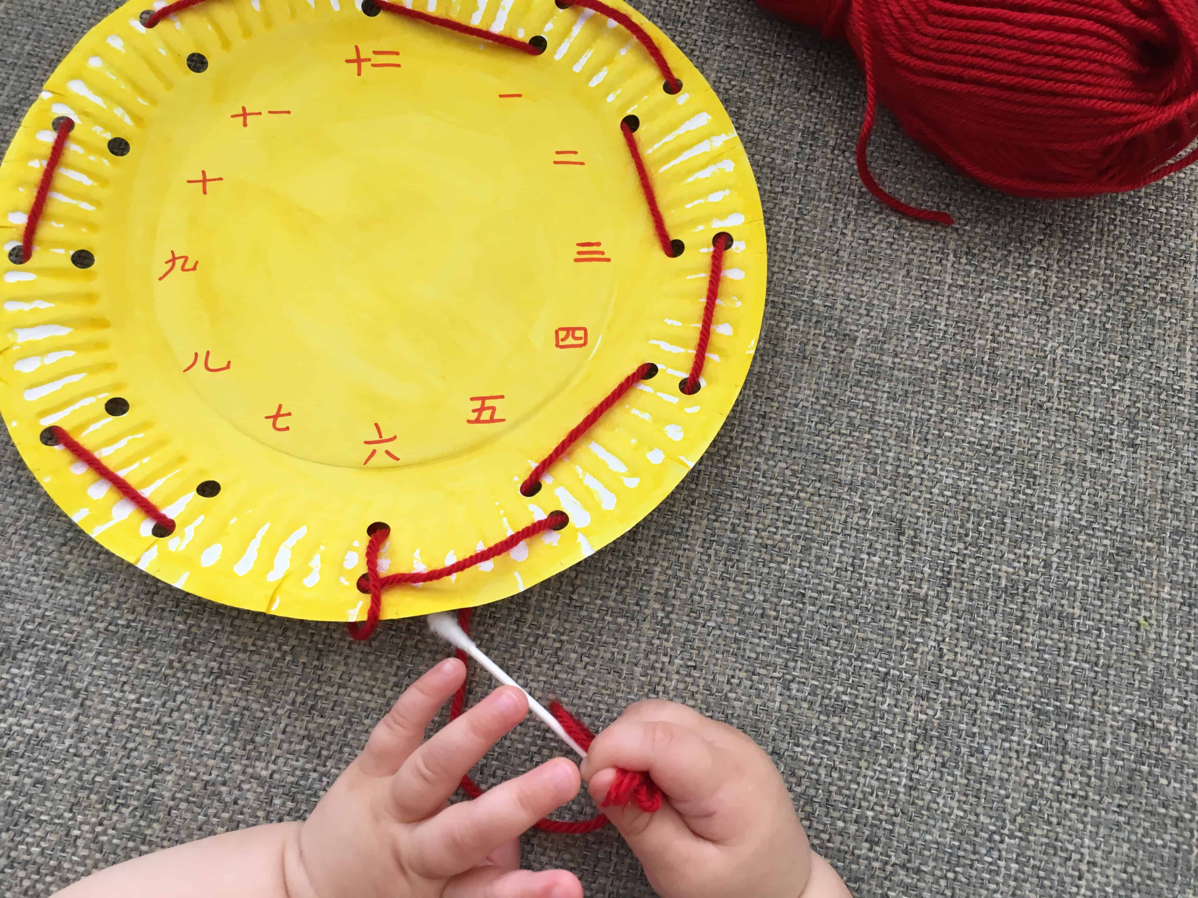 Paper Plate Clock Face Threading – A Fine Motor Numbers Activity for Kids!