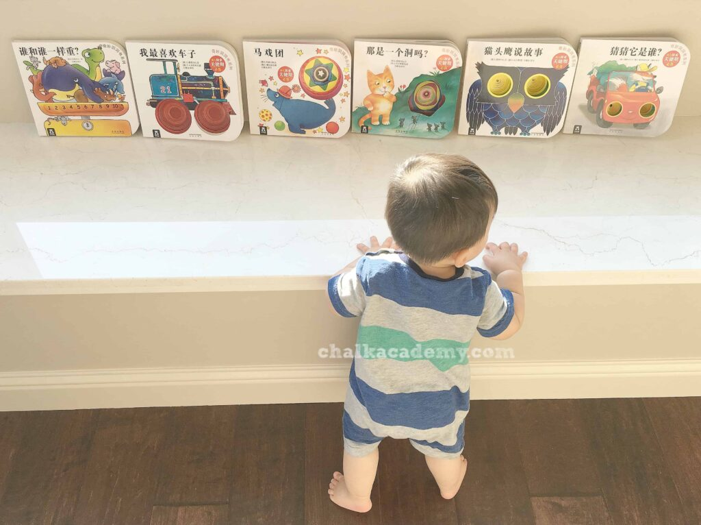 Display books with front cover showing - motivate child to read inspired by Montessori method