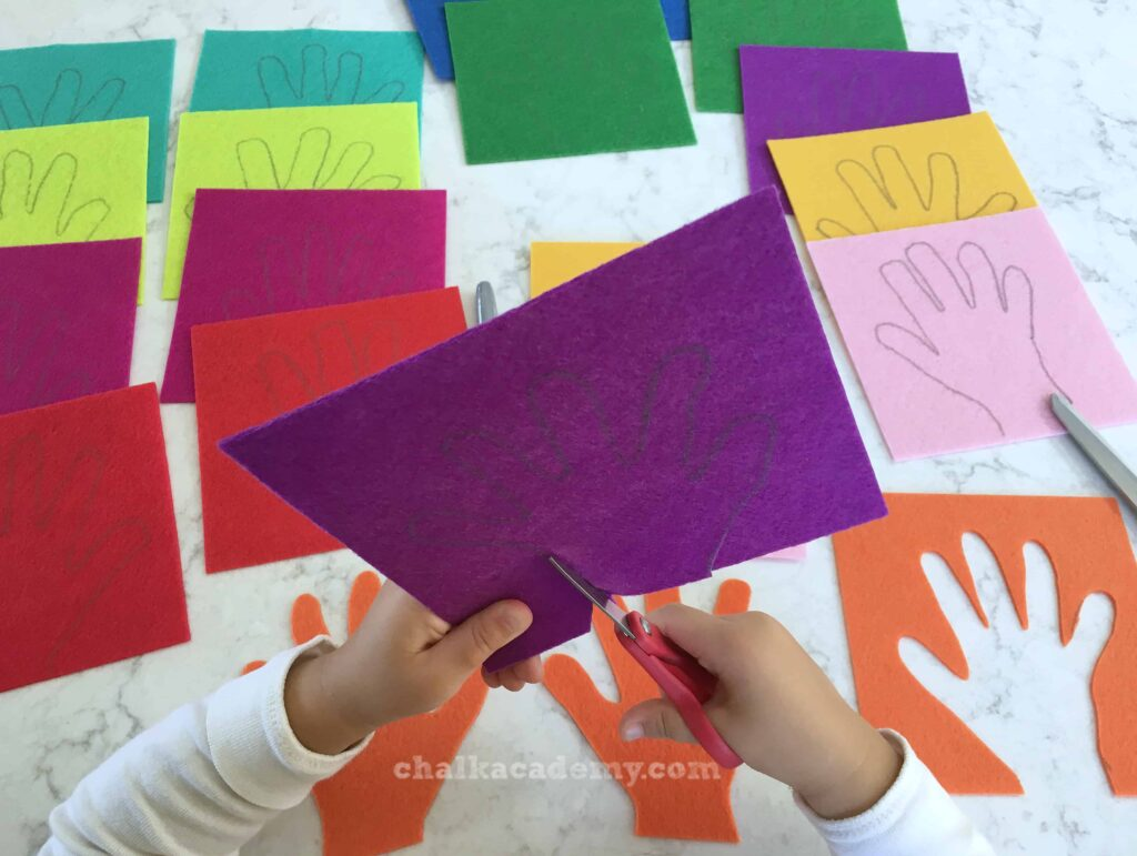 Getting ready to cut hand shapes on colorful felt! Red, Orange, Yellow, Green, Blue, Purple, Pink