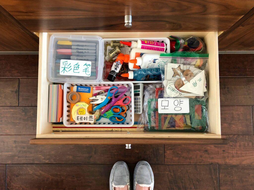 Homeschool Tour - art storage in dining room cabinet