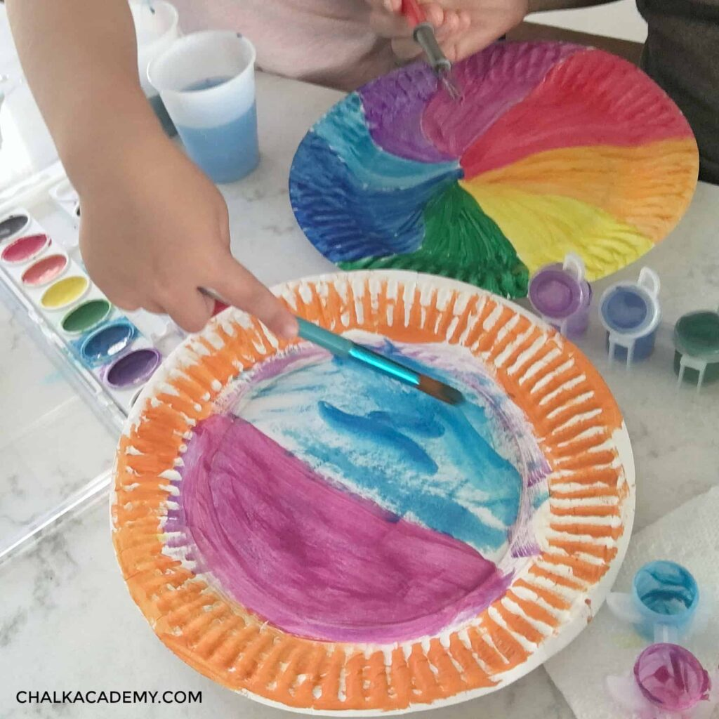 Painting paper plates with color - process art