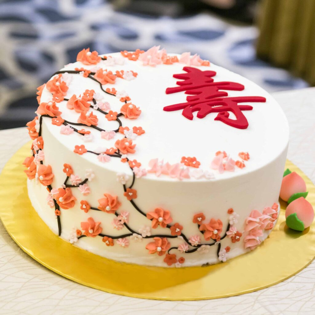 Decorated birthday cake celebration for elderly person with Chinese word Longevity