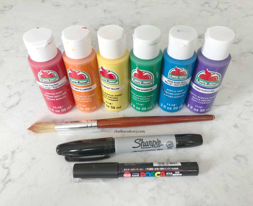 Acrylic paint, paint brush, Sharpie, and Posca paint pen