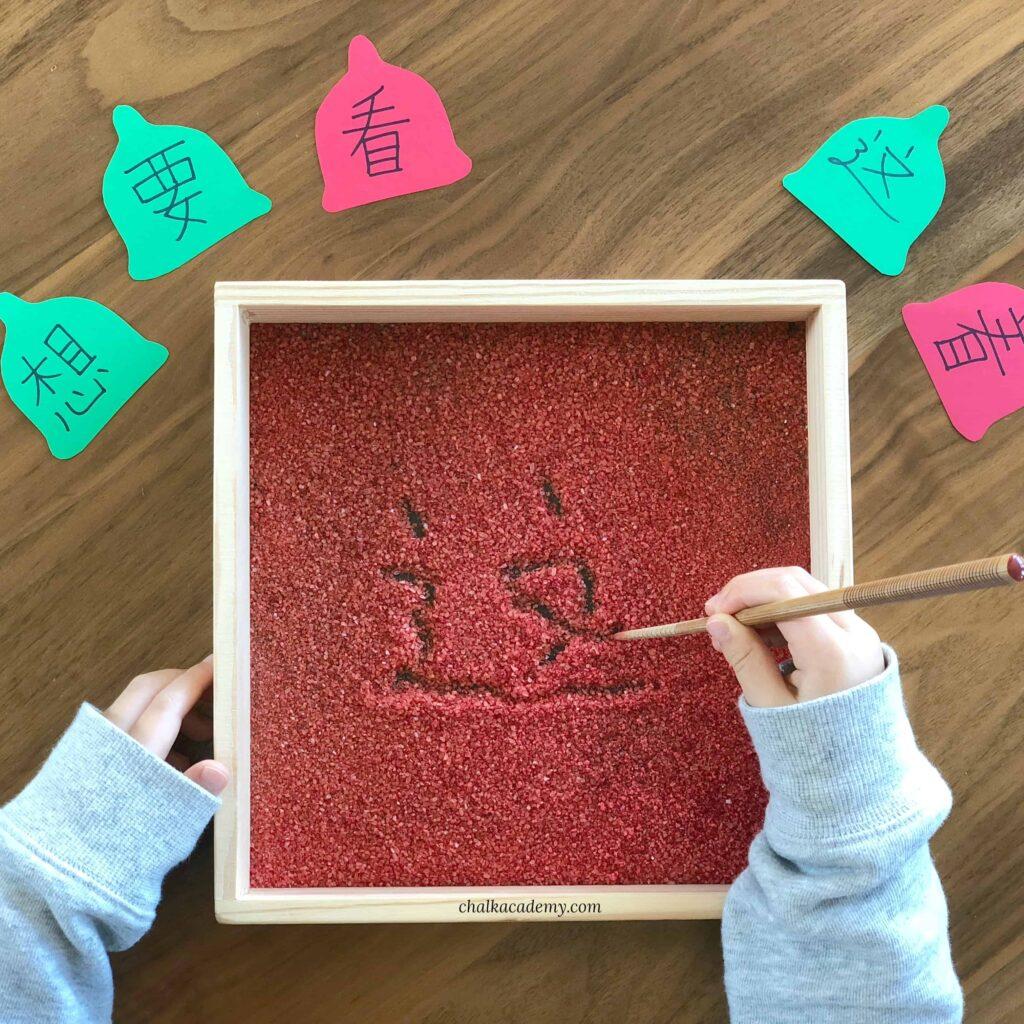 Montessori salt-writing tray Christmas learning activity for kids