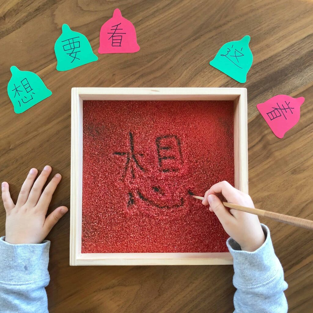 Montessori salt-writing tray Christmas learning activity for kids