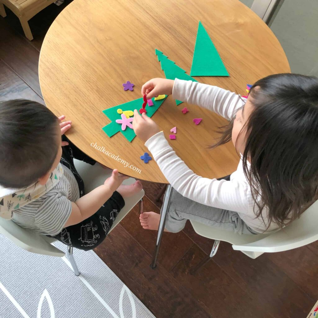Felt Christmas Tree Busy Bag Activity - Children working together
