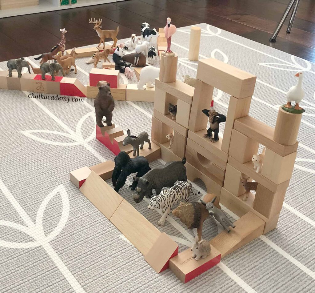 Natural wood blocks and Schleich official animals - best toys for kids