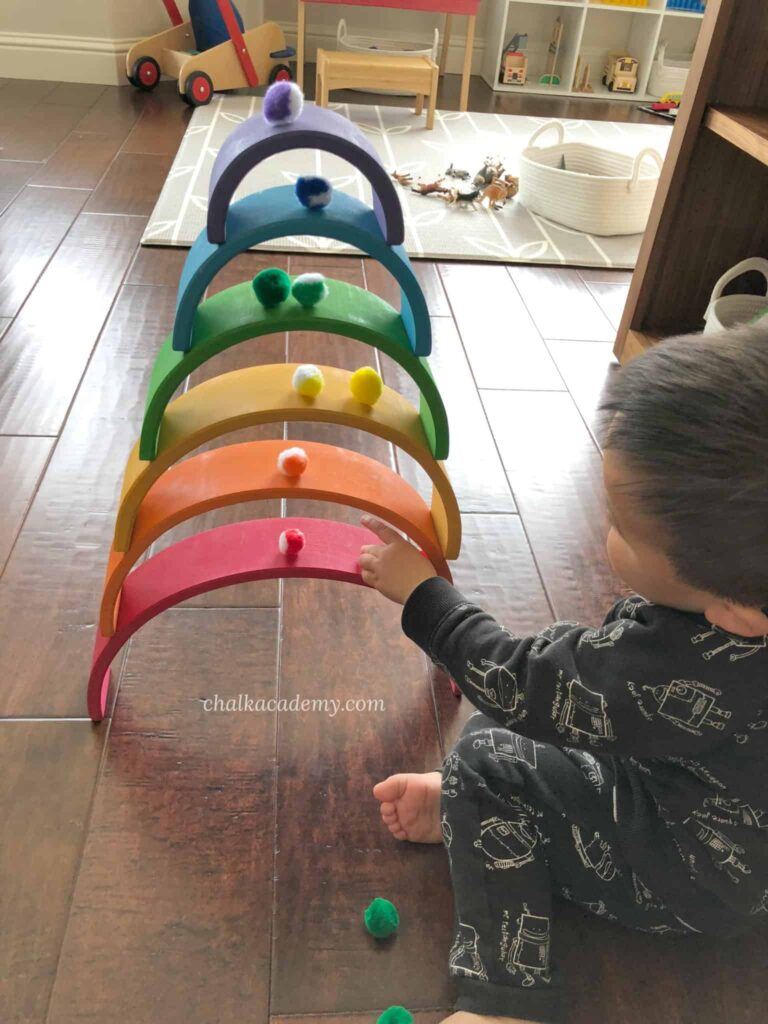 Grimms rainbow stacker and pom poms