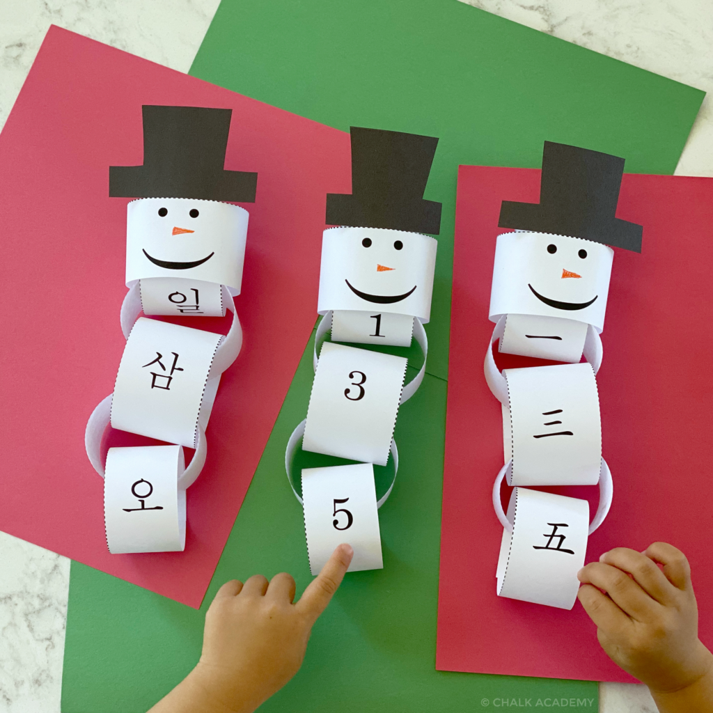 Christmas Countdown with paper chain snowmen printable template in Chinese, Korean, and English
