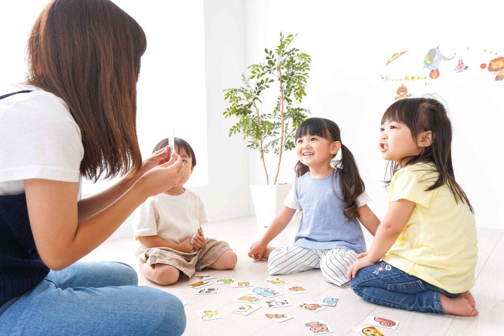 Asian children learning from teacher