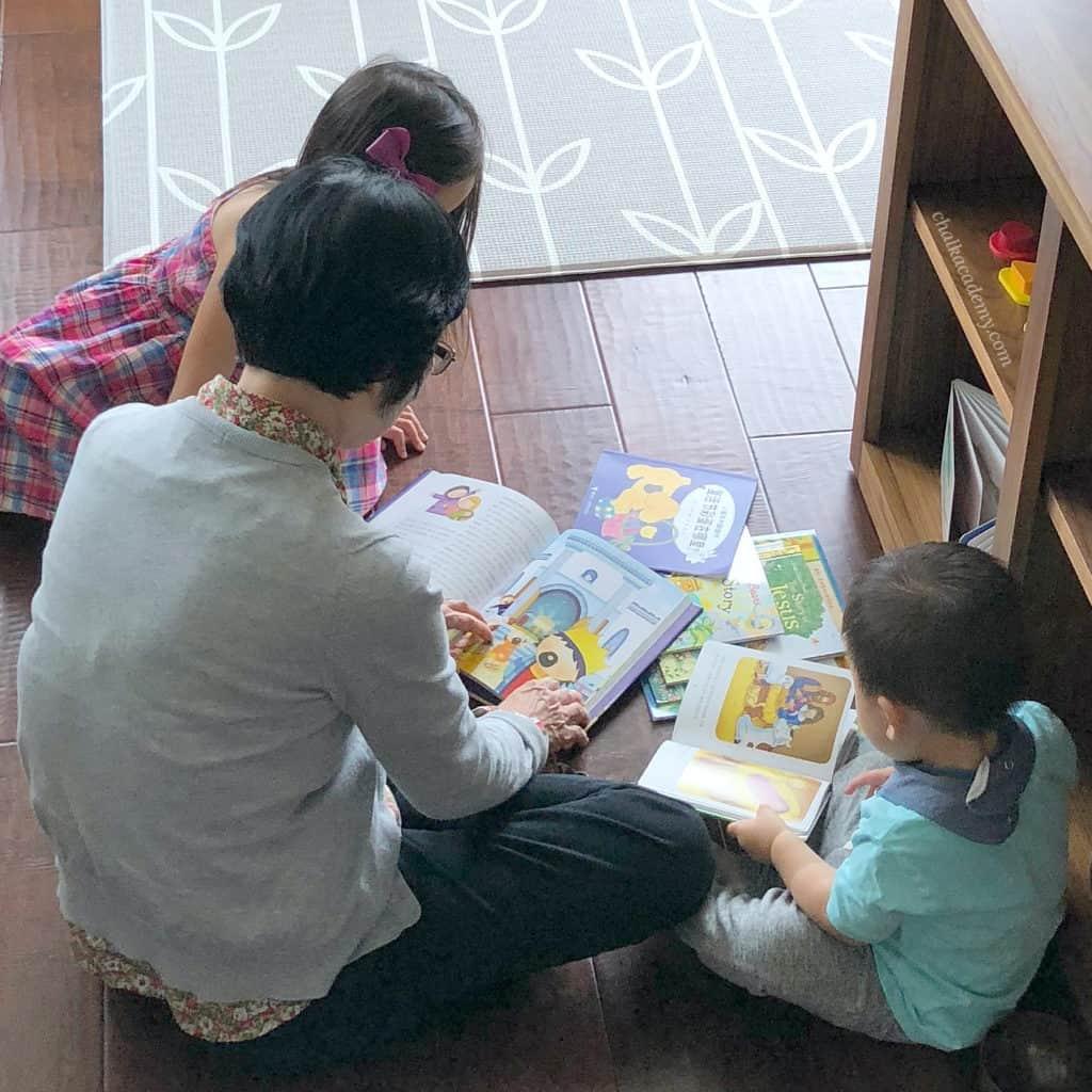 Korean Asian nanny reading happily to my children