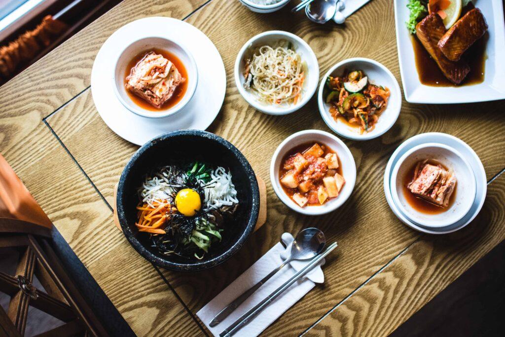 Korean bibimbap, kimchi, and side dishes at Korean restaurant