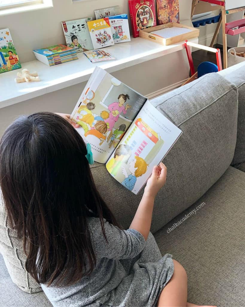 Girl reading Chinese math story books for elementary and primary school
