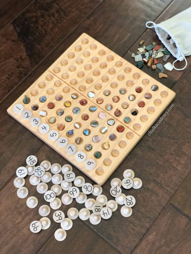 Counting and sorting rocks with a Wooden Montessori Hundred BoardCounting and sorting rocks with a Wooden Montessori Hundred Board