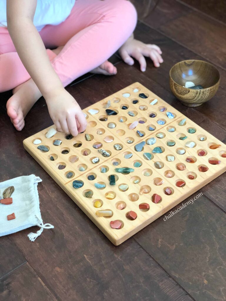 Counting and sorting rocks with a Wooden Montessori Hundred Board