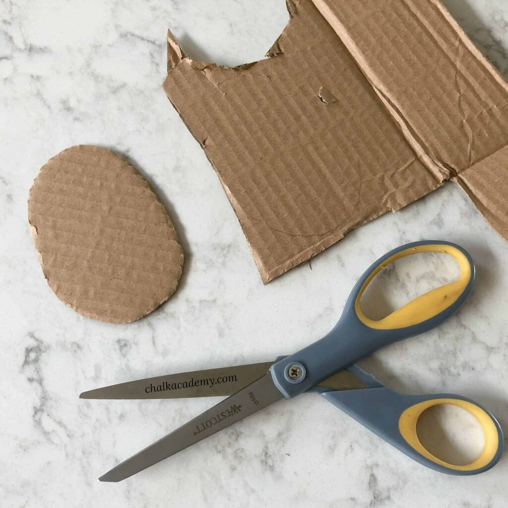Cutting cardboard egg