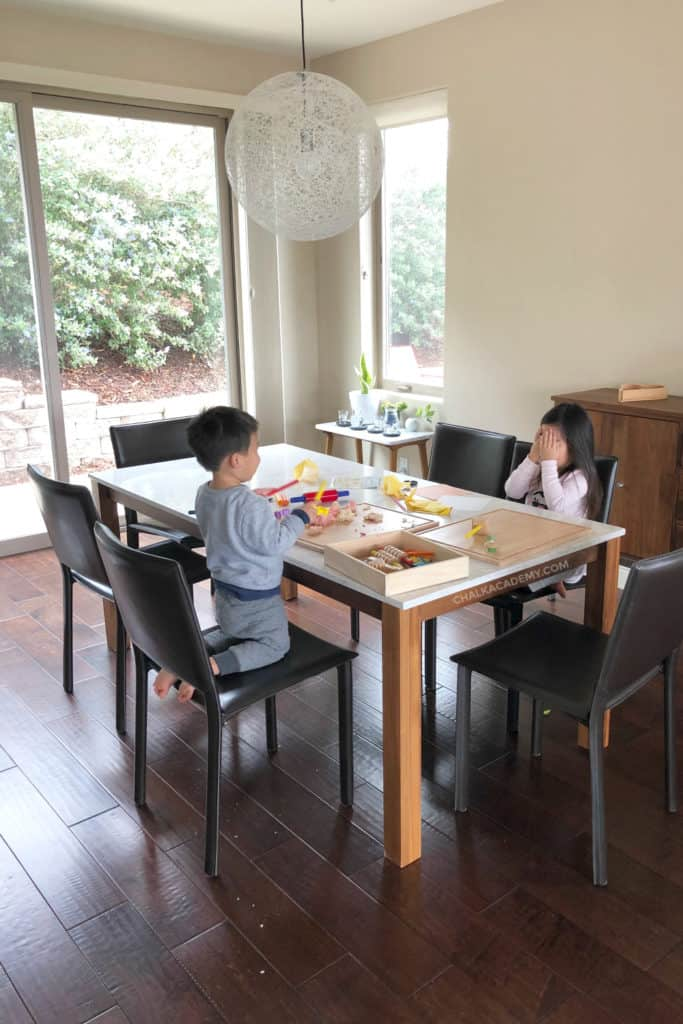 Children playing with play dough in dining room