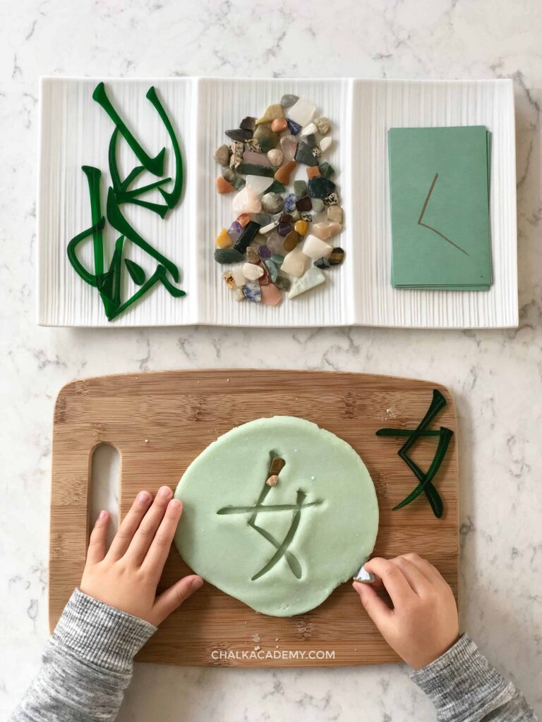 Tracing Chinese character with rock tracing in play dough
