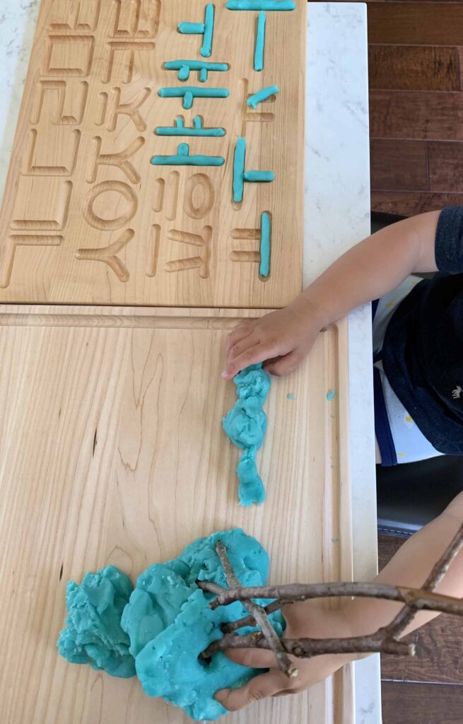 Playing with homemade blue jello play dough