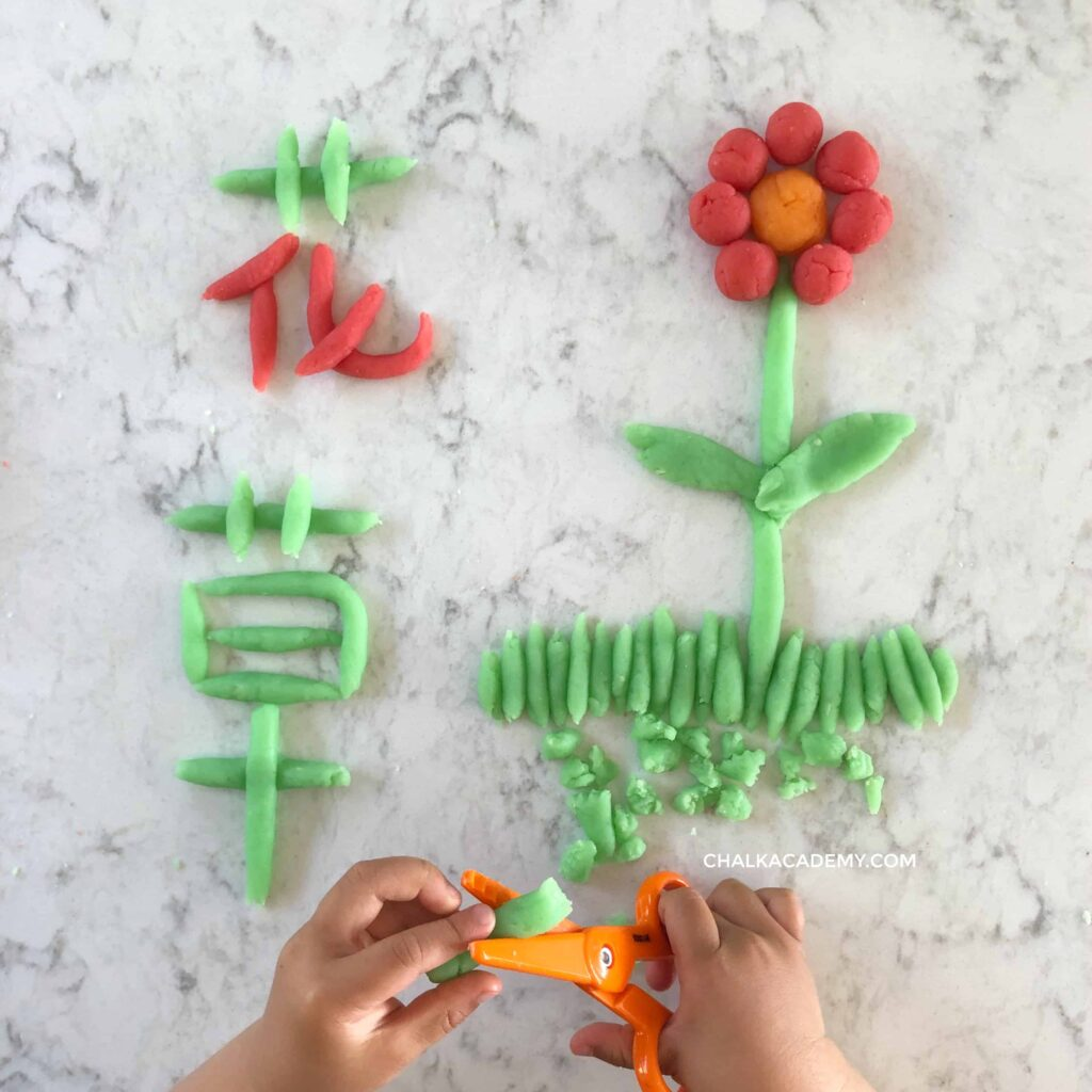 Writing Chinese characters flower and grass with play dough
