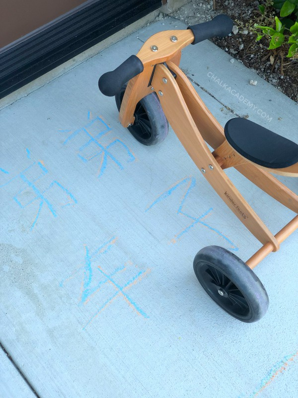 Label tricycle parking spot with chalk