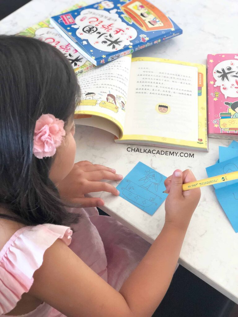 Girl drawing Chinese cartoon character from 米小圈上学记 Chinese Bridge Book About School Life in China