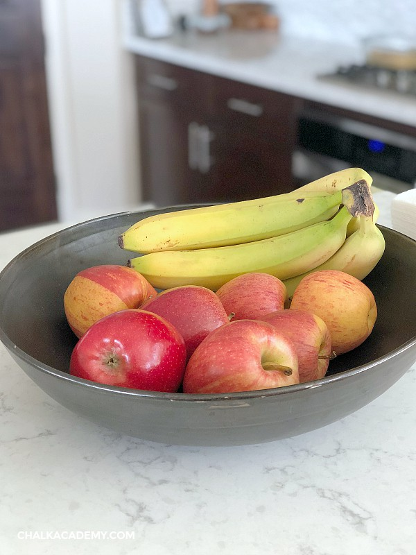 Bow of red apples and yellow bananas