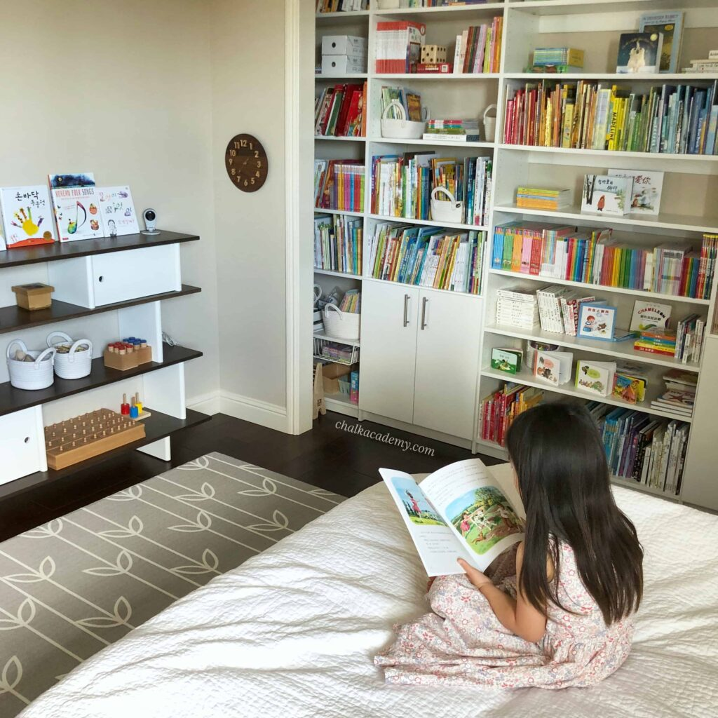 Daughter reading Chinese book in bedroom library