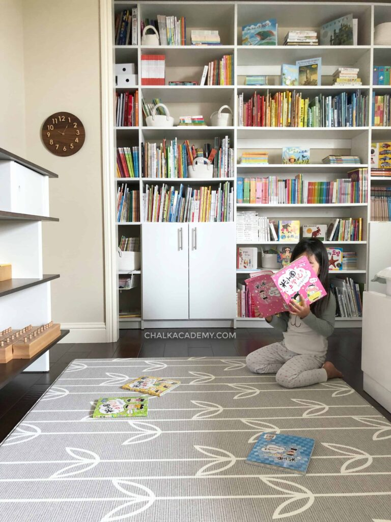 My daughter reading in her trilingual library bedroom