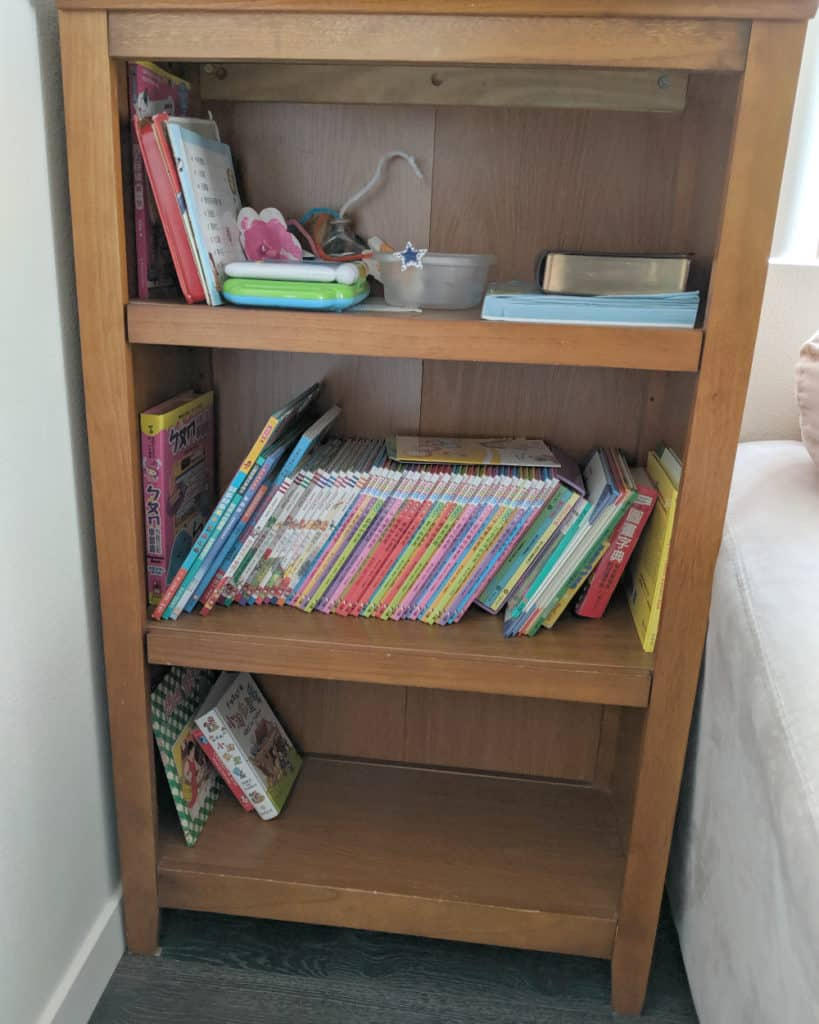 Raising trilingual kids: Bookcase with Korean and English children's books in a trilingual American family's home