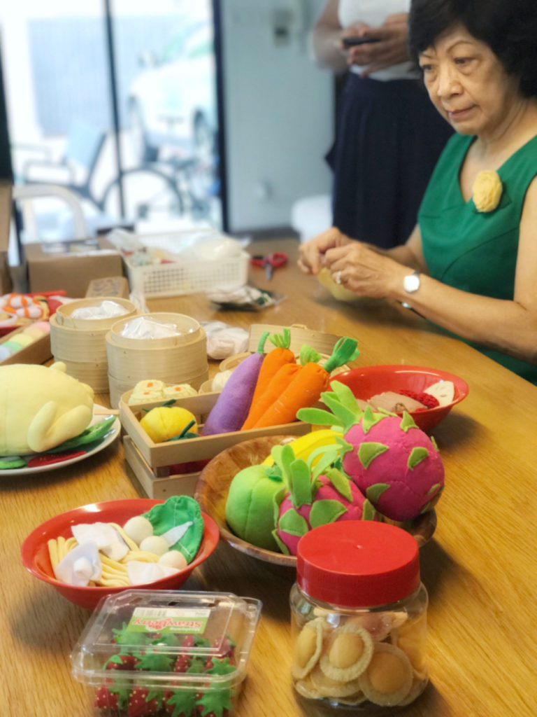 Lianne Ong's mother creating Asian felt food toys for Heart Felt Makan