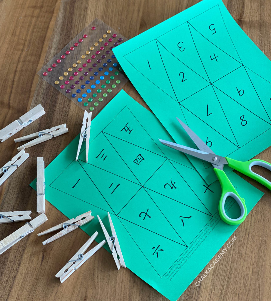 Clothespins, colorful bump stickers, scissors, and printable template for Christmas tree activity in Chinese and English