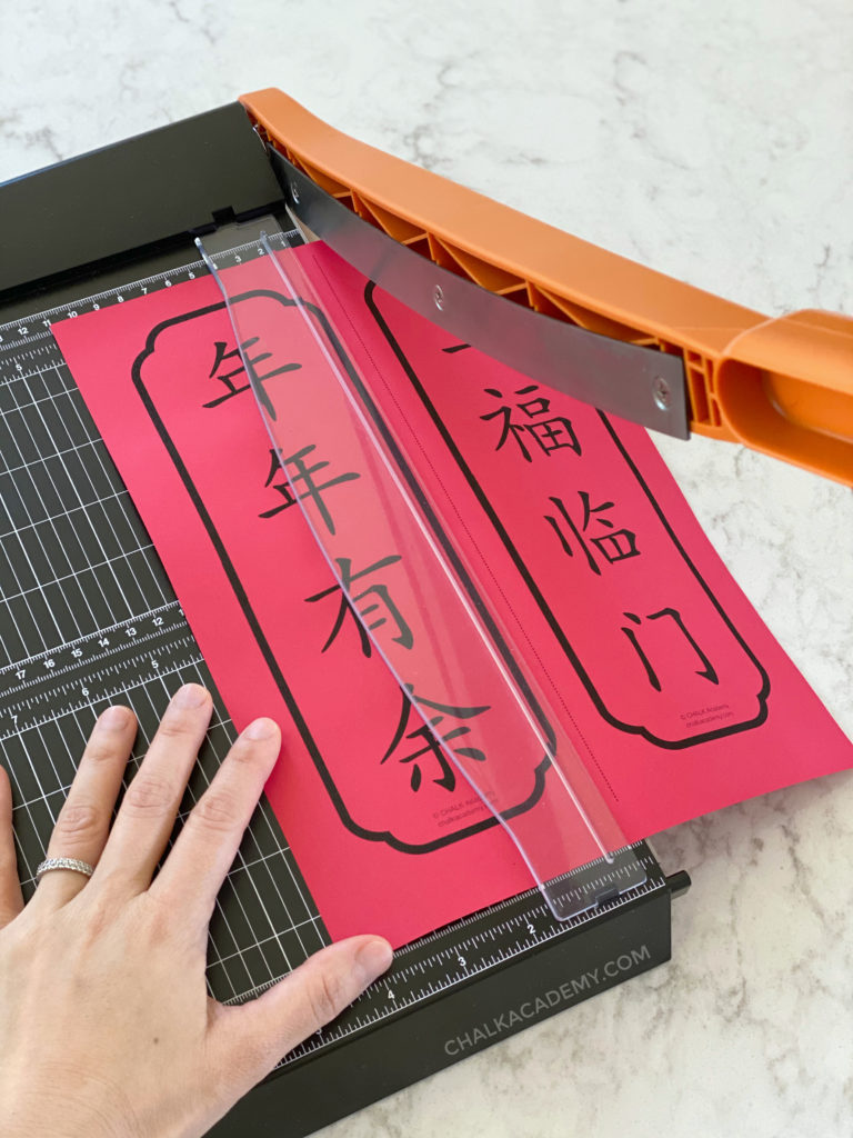 Cutting Chinese Banners with paper cutter