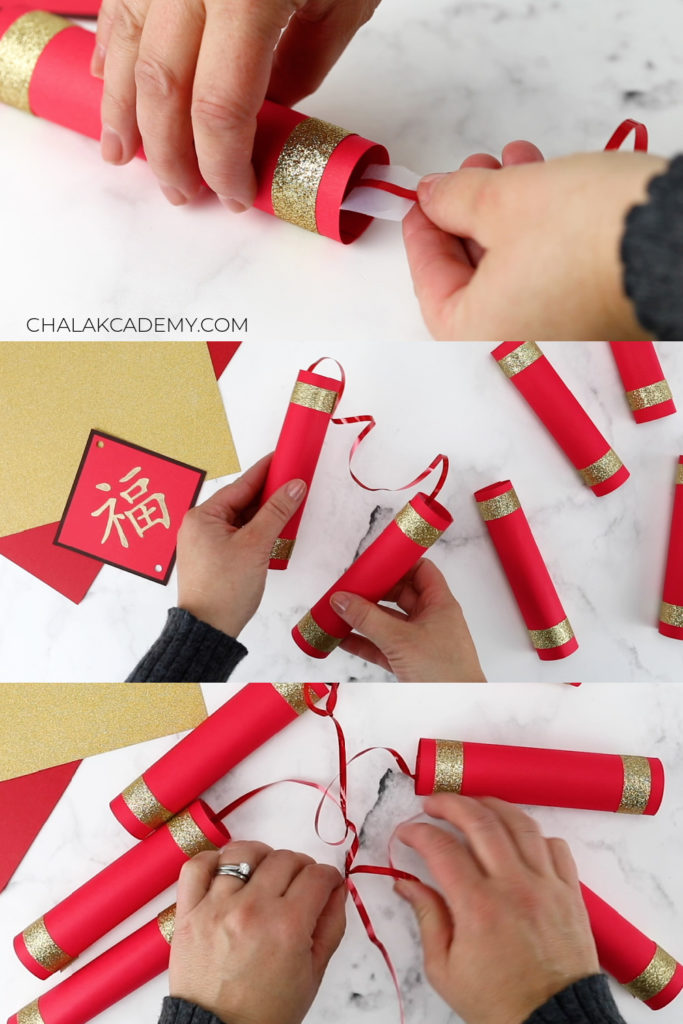 Pairs of Chinese firecrackers taped together by ribbon; each pair is tied to long center ribbon