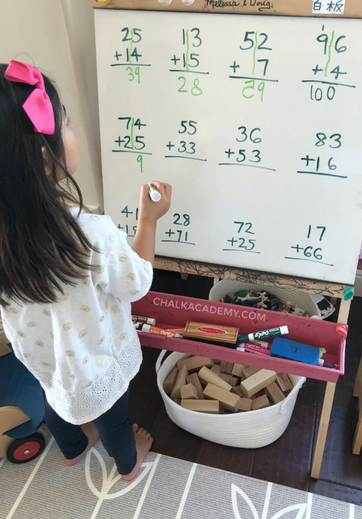 Child learning math problems in Chinese