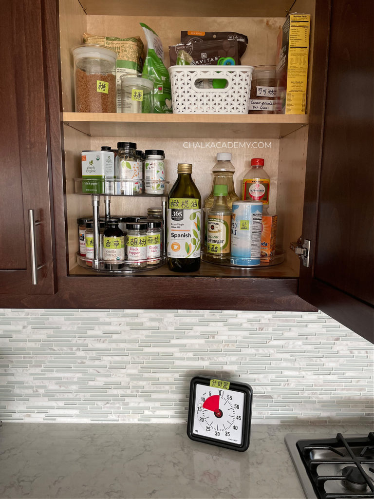 Spice rack organization, lazy susan in kitchen cabinets; How We Keep our Kitchen Safe and Organized with Kids