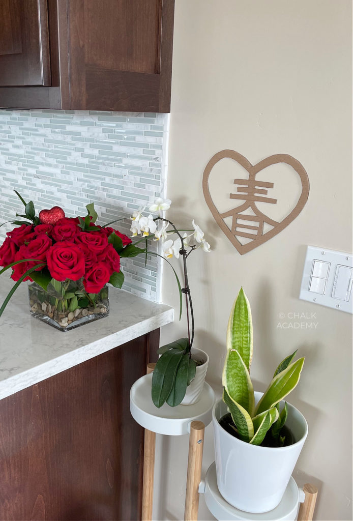 bamboo plant stand, cardboard Chinese spring heart cutout
