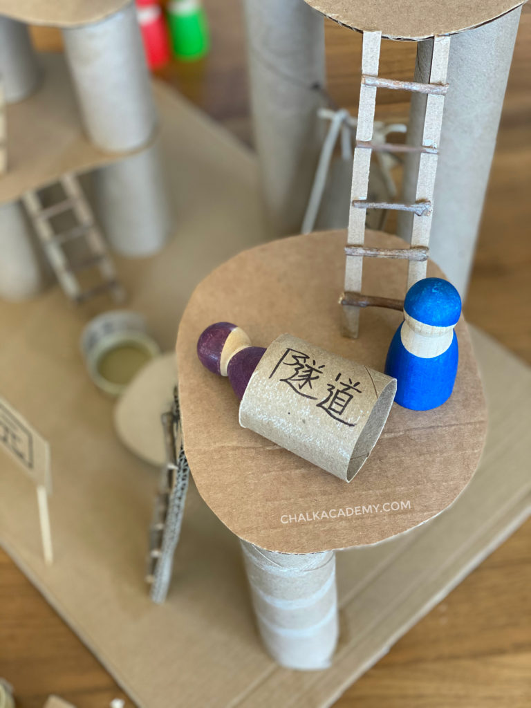 DIY cardboard tunnel and ladder for miniature small world playground