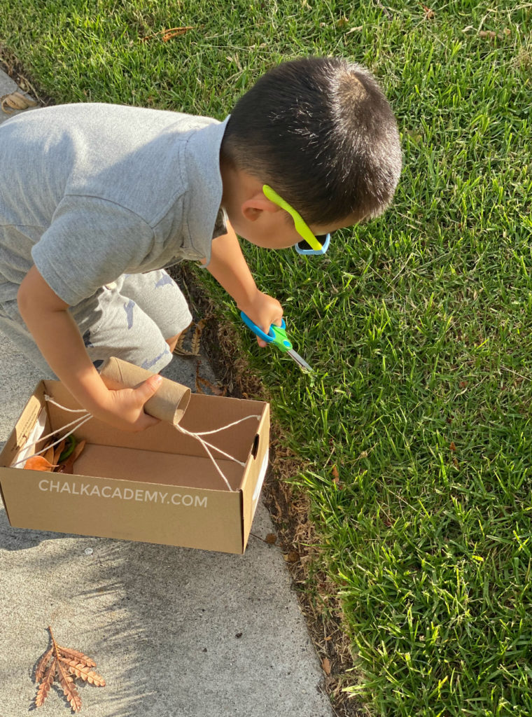 Nature scavenger hunt for kids with basket made of toilet paper roll and cardboard shoebox! Scissor cutting practice with grass