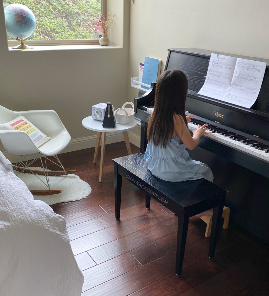 Black upright Boston piano, Modernica mid-century modern rocking chair