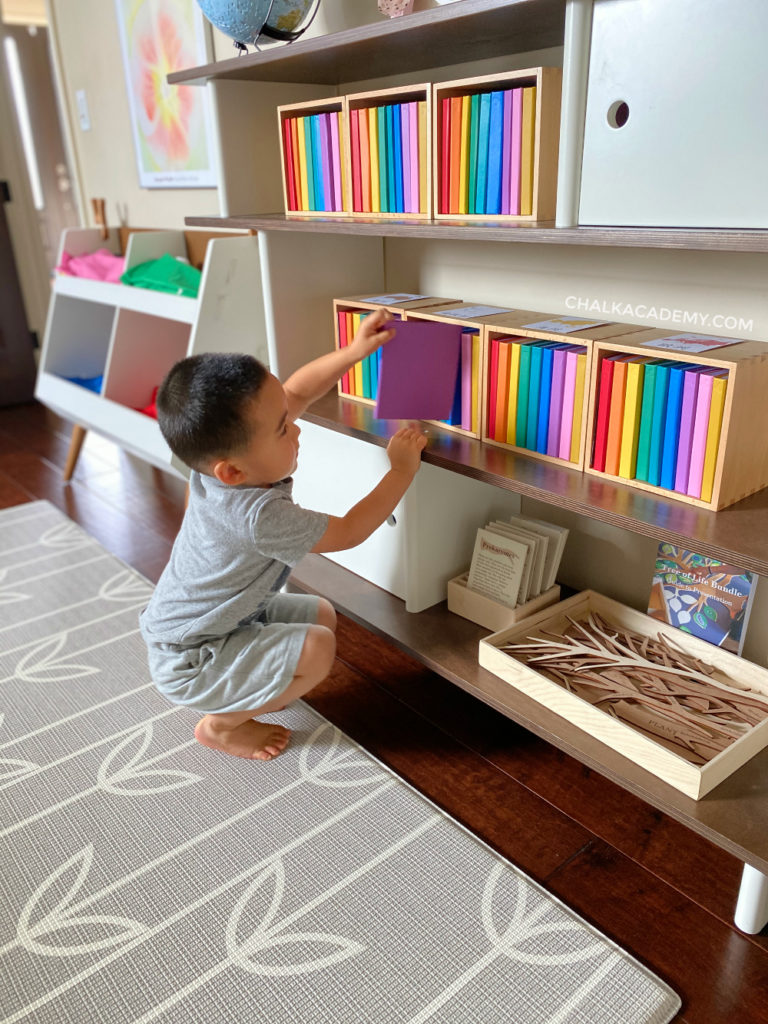 Mid-century modern kids' Oeuf mini library bookcase in walnut; Waseca Biomes Rainbow Leveled Readers