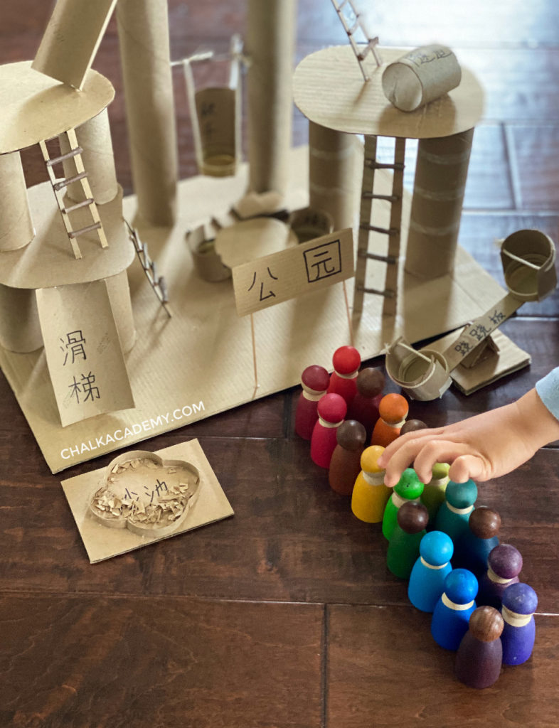 DIY cardboard toy with wooden peg dolls