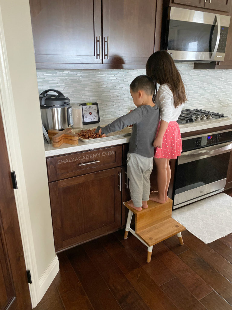 Kids cooking together is part of homeschooling