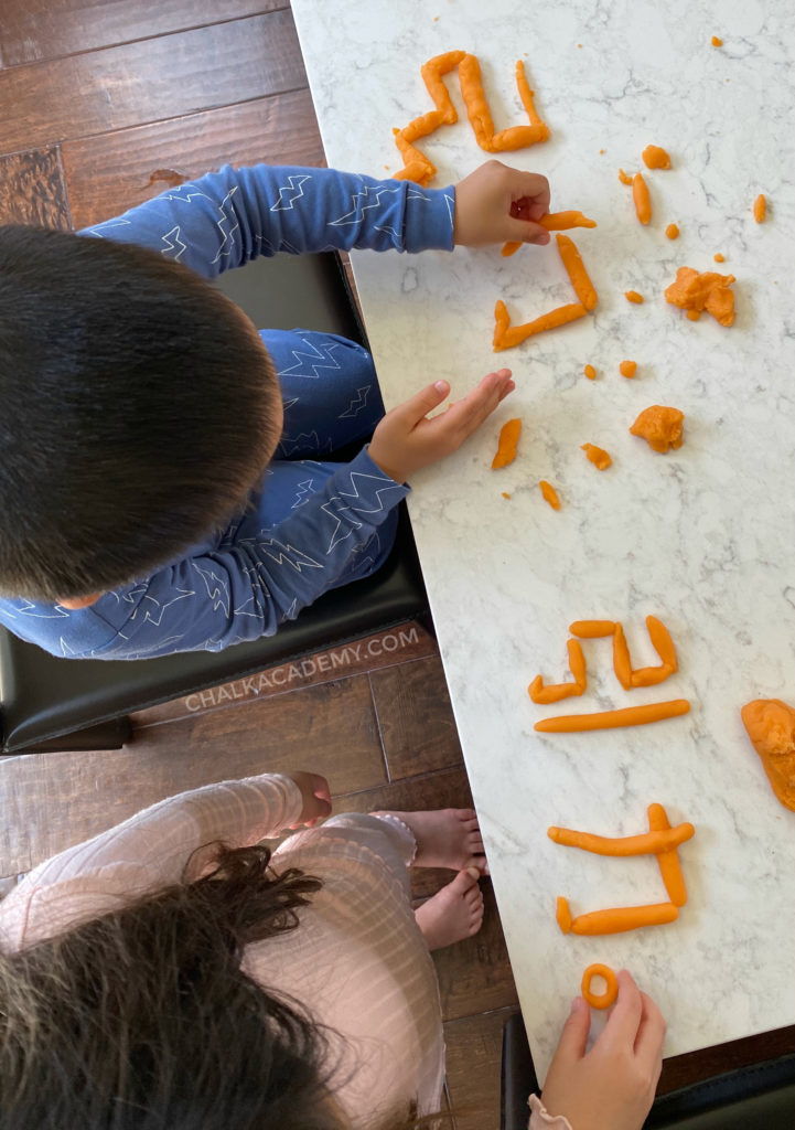 Making Chinese characters with play dough