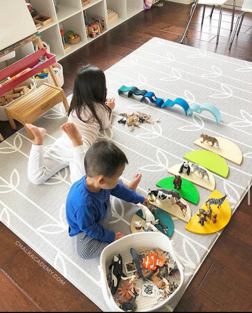 Boy and girl playing with open-ended toys