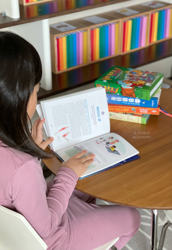 Daughter reading children's bible stories and devotions in Chinese and English
