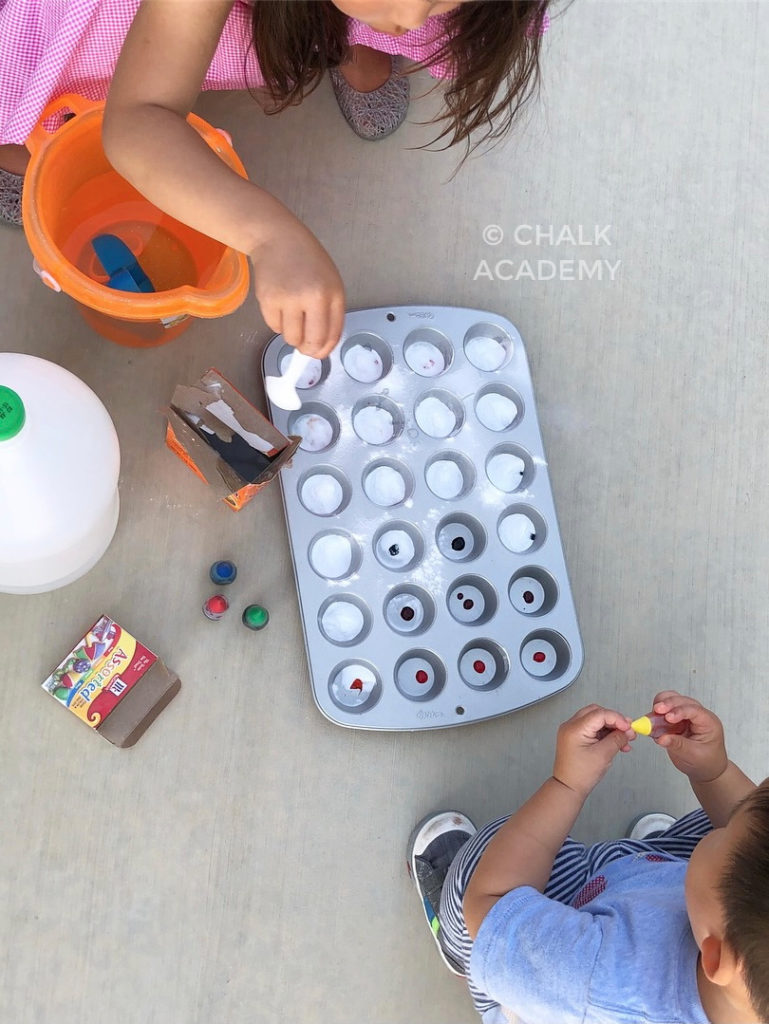 Scooping baking soda into muffin pan mystery colors activity kids science experiment
